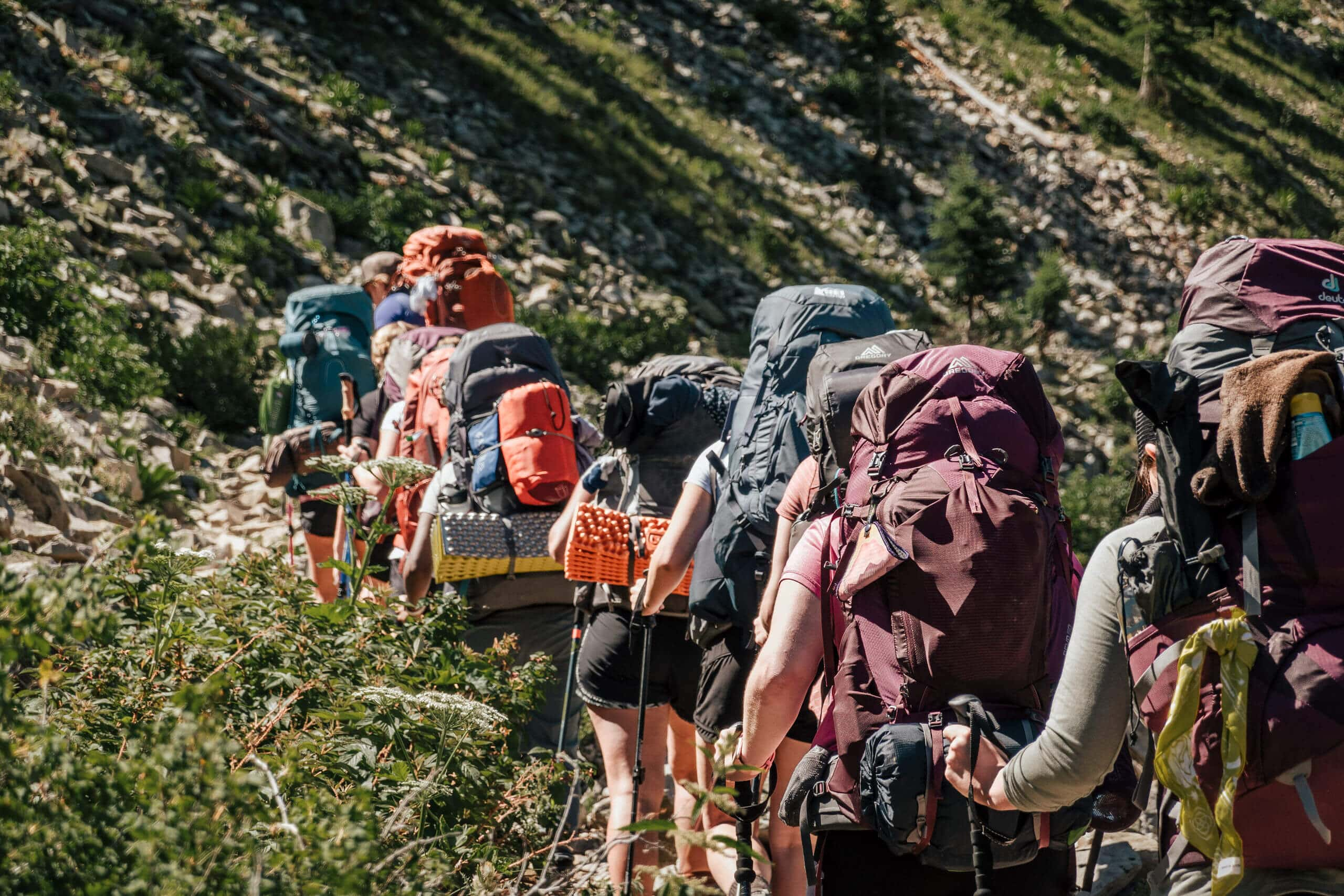 Backpackers in a line on Tents Without Gents trip